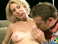 Sexy Babe Erica Lauren gets extreme delight as her young stud suck her yummy tits!